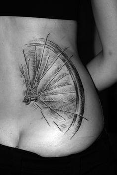 tattoo bike wheel
