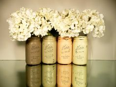 painted and distressed mason jars with fake hydrangeas. Cute color palette!