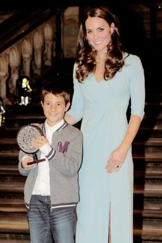 """Catherine, Duchess of Cambridge presents the Young Wildlife Photographer of the Year award to Carlos Perez Naval at the Natural History Museum as she attends the Wildlife Photographer of The Year 2014 Awards Ceremony on October 21, 2014."""""""