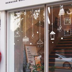 These are actually decals, but good design inspiration if you're painting your consignment or resale windows. Don't want lights? Try hangers! This makes your display windows a word-of-mouth treat, but doesn't obscure your merchandise displays.