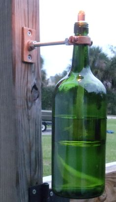 Personal Creations #Gifts  #Personalizedgifts This here is my personal creation... http://www.etsy.com/listing/58907463/repurposed-wine-bottle-tiki-torch - Great Personalized Gifts via- http://www.AmericasMall.com/personalcreations-gifts