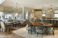 Shape if kitchen with lots of windows and seating area in addition to table and bar seating