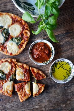 grilled naan break mozzarella and basil pizzas...so easy for any dinner party!