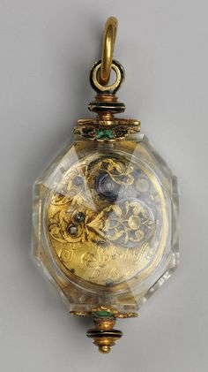 Watch, c. 1630 - 1640. Movement by Johann Possdorffer. The case is made of rock crystal and gold, and partly enameled. The dial is painted enamel on gold, with a single gold hand. The movement is made of gilded brass and steel