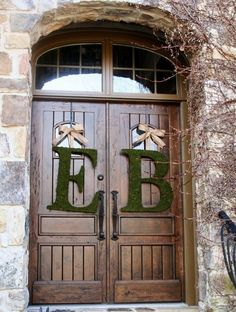 Another photo displaying these beautiful moss covered initials. Loving them on these rustic wood church doors. Wedding ideas. Rustic wedding. Moss initials. Wedding wreath.