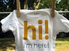 hi i'm here --- white onesie, size 0 - 3 months.  $14.00