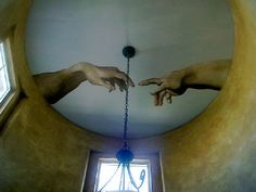The hand of God touching the hand of Adam was painted 16' up on an entryway ceiling in a private residence.