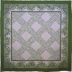 "Emerald Spring, 89 x 89"", by Nancy Rink.  Myriad green fabrics, from dusty blue-greens to clear yellow-greens, comprise this quilt."