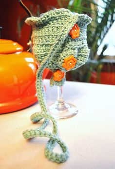 Heading to the Food and Wine Show and was inspired to crochet a wine glass carrier, free-hand...now to make a pattern.