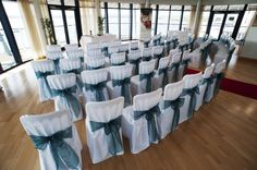 Chair covers and teal sashes