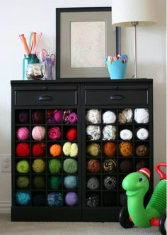 Wine rack for yarn storage. This is awesome... Now if only I had a craft room