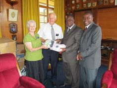 Elder and Sister Bean, missionaries for The Church of Jesus Christ of Latter-day Saints & Country Directors of Humanitarian Services for Zimbabwe, Malawi, and Zambia, present donations to Mayor Thaba Moyo.