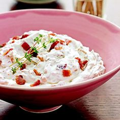 Caramelized Onion-Bacon Dip Recipe from Ladies' Home Journal. Onion dip is always a favorite but add bacon to make it even better. Serve it with crackers, chips, or vegetables for a snack or appetizer.
