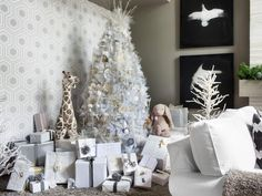Now let's turn our attention to the star of the party, the #Christmas tree.  For this year's HGTV #HolidayHouse, Casey went with a sophisticated, tone-on-tone style incorporating shades of white, cream, dove gray and silver.