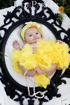 Baby laying in a frame. Cute!!