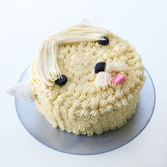 Cute Terrier Dog Cake Who let the dogs out? This spectacular little fluffball cake will make the cutest doggy statement at a child's birthday party or a gathering of dog-lovers.