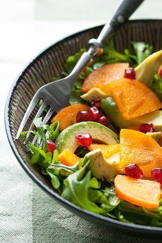 Persimmon, pomegranate and avocado bright winter salad