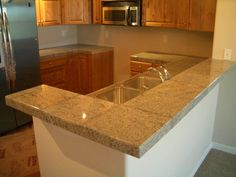 Granite tile counter tops. the same look as granite but waaay cheaper. and my hubby knows how to do tile ;)
