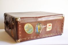 Midcentury Brown Suitcase - Steamer Trunk - With Authentic Travel Stickers,  by thelittlebiker  Beautiful chocolate brown steamer trunk from the '50s, with authentic travel stickers, perfect for display, used as a side table, also for stacking or storage or as a photo prop.