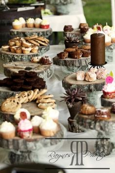 Tree stump cake stands. So cool for a rustic/woodsy wedding. I am obsessed with cake stands