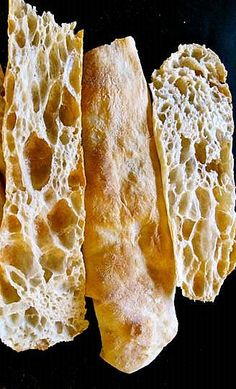 Pan de Cristal (Spanish Crystal/Glass Bread). alternate here: http://translate.google.com/translate?sl=auto&tl=en&js=n&prev=_t&hl=en&ie=UTF-8&u=http%3A%2F%2Fwww.hoteleslaserena.com%2Fpersiguiendo-al-pan-de-cristal%2F or here: http://translate.google.com/translate?sl=auto&tl=en&js=n&prev=_t&hl=en&ie=UTF-8&u=http%3A%2F%2Fwww.vegetalytal.com%2F2012%2F06%2Fpan-de-cristal-primer-intento.html or here: http://www.thefreshloaf.com/node/19830/36-hours-sourdough-baguette-everything-i-know-one-bread