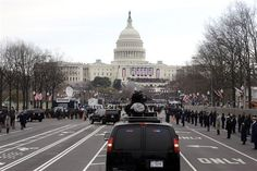 President Barack Obama and first lady Michelle Obama ride up Pennsylvania Avenue in the presidential motorcade towards the U.S. Capitol in Washington, Monday, Jan. 21, 2013, ahead of his ceremonial swearing in during the 57th Presidential Inauguration.