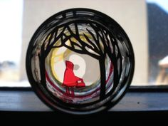 Diorama in a film canister using paper and stage light gels