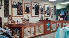 """Spectacular consignment shop in AZ: her son designed + built the cases out of recycled wood from a local school & AZ copper... the turquoise hangers and star are store branding... and the displays framed on the wall: gorgeous! Too Good to be Threw declares this to be """"a consignment shop that wows its clientele!"""""""