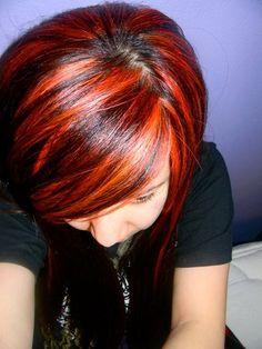 orange/red highlights in dark hair
