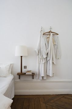 Nightstand Simple Shelf. I love the hooks beside and the tall light