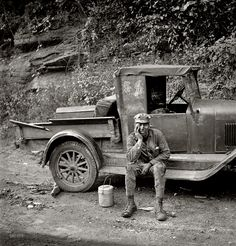"Homeward Bound: September 1938. Capels, West Virginia. ""Miner waiting for ride home. Each miner pays twenty-five cents a week to owner of car."" Medium format negative by Marion Post Wolcott for the Farm Security Administration."