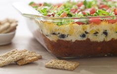 Great for parties and before-dinner appetizers. Uses ricotta instead of sour cream.  Warm 6-Layer Ranchero Dip with Kashi® Crackers Recipe. #kashibetterrecipes