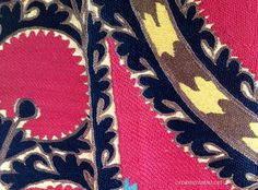 detail of a splendid pink and black Suzani