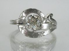 Unique vintage old European cut diamond ring crafted in 3.5 grams of 10K white gold, $750.00