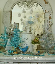 Beautiful. Use eastlake white dresser, blue accent, tinsel small tree, white pine cones and ironstone.