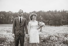 Eleanor and her hubby Drew are stunning in this meadow of flowers. Eleanor's short lace gown is essentially two wedding gowns - a strapless underdress and a lace overlay dress with long sleeves, a fitted waistline and just-above-the-knee hemline!