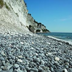 Cliffs in Denmark awarded World Heritage status by UNESCO as they preserve evidence of the K-T boundary.