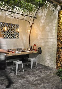 With old bricks, wire pendent lights, huge metal beams and rusted pipes lashed together to make the enclosed courtyard, it is a modern industrial take on a natural outdoor space.
