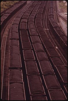 Original Caption: Loaded Coal Cars Sit in the Rail Yards at Danville, West Virginia, near Charleston. Awaiting Shipment to Customers. It Is One of the Largest Transshipment Points for Coal in the World. A Constant Stream of Rail Cars Is Moved in and Out of the Small Town