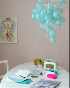 bubble chandelier...clear Christmas ornaments, some painted inside with shades of aqua...for dessert table centerpiece