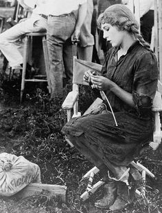 """Mary Pickford knits sweaters for WW1 veterans during break from filming """"Sparrows"""" - 1926"""