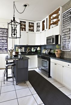 white kitchen with dark grey counter and backsplash
