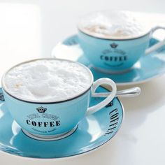 Blue cups of cappuccino