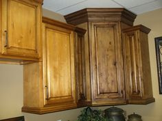 Hoping I can transform my honey oak cabinets to this with antiquing glaze.