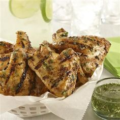 The tangy cilantro-lime dipping sauce for these grilled chicken wings is inspired by a Mojito!