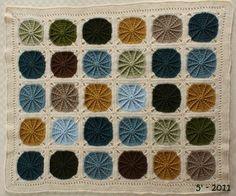 A beautiful Sunny Spread blanket. Pattern here http://www.coatsandclark.com/NR/rdonlyres/73826811-2FA1-4DF8-B9C7-57373C9635E8/123469/CTFeb0869.pdf
