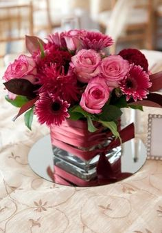 burgundy and pink centerpieces