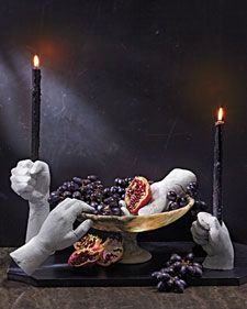 Halloween - candle holders made from plaster molds of the homeowners' hands