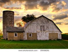 beautiful sky behind this old beautiful barn.