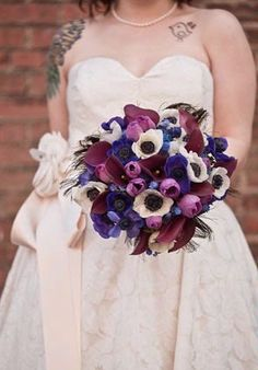 Love this bouquet with anemones and peacock feathers.